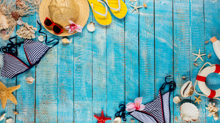 Beach accessories placed on blue wooden planks, top view. Summer holidays concept, free space for text. Very high resolution image Archivio Fotografico - 100508307