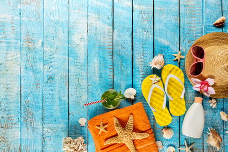 Beach accessories placed on blue wooden planks, top view. Summer holidays concept, free space for text. Very high resolution image Archivio Fotografico - 100508313