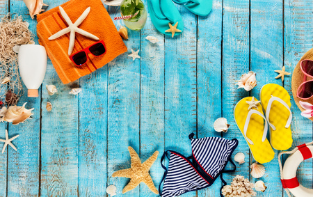 Beach accessories placed on blue wooden planks, top view. Summer holidays concept, free space for text. Very high resolution image Archivio Fotografico - 100508320