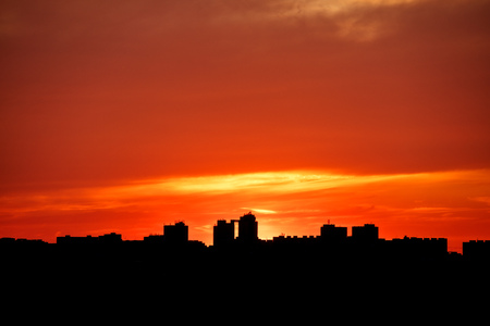 Modern city skyline with skyscrapers silhouettes in beautiful sunset