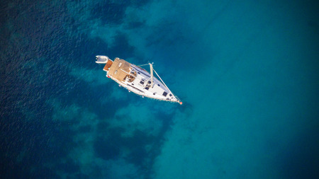 Aerial view of sailling boat. Outdoor water sports, yachting.