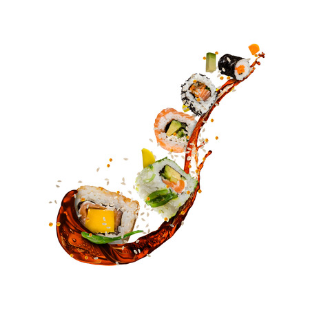 Flying sushi pieces isolated on white background. Concept of food levitation, high resolution image Standard-Bild - 101648313