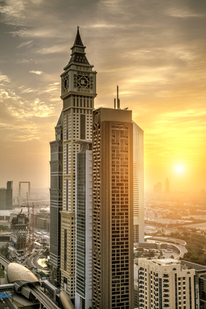 Downtown of Dubai city with high skyscrapers at sunrise. Dubai is super modern city of UAE, cosmopolitan megalopolis. 写真素材