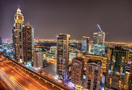 Dubai night panoramic view of Sheikh Zayed road. Dubai is super modern city of UAE, cosmopolitan megalopolis. 写真素材