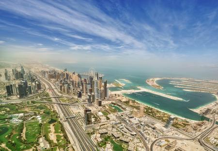 Aerial view of Dubai Marina downtown, panoramic view from airplane window.
