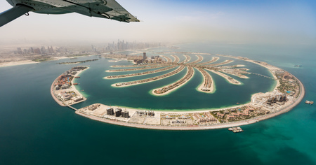 Aerial view from airplane window, artificial palm island in Dubai. Panoramic view. Archivio Fotografico