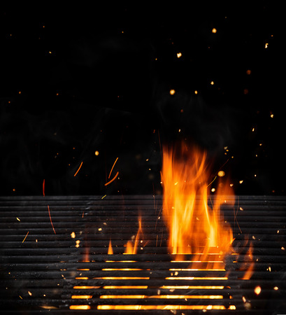Empty grill with cast-iron and flames, ideal for product placement. Very high resolution image