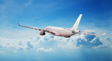 Commercial airplane jetliner flying above clouds. Transportaton and travel around the world. Fastest mode of transportation Stok Fotoğraf