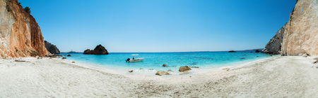 Beautiful panoramic view of Kefalonia island with beaches, Greece. Small motor boat anchoring in bay Stock Photo