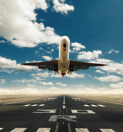 Commercial airplane taking off runway in day light. Concept of modern fast traveling
