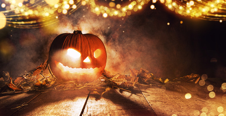 Spooky halloween pumpkin on wooden planks in dark cellar. Celebration theme, copyspace for text. Very high resolution image Stock Photo