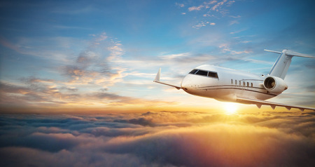 Luxury private jetliner flying above clouds. Modern and fastest mode of transportation, symbol of luxury and business traveling.