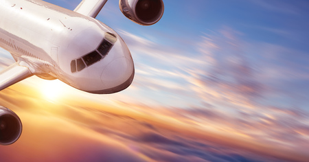 Close-up of commercial jetliner flying at high speed. Concept of modern and fastest way of transportation and danger of accident.