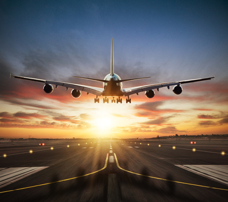Huge two storeys commercial jetliner taking of runway. Modern and fastest mode of transportation. Dramatic sunset sky on background 스톡 콘텐츠