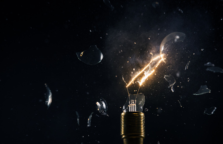 Freeze motion of old light bulb explosion on black backround. Concept of new idea and brain storming. 스톡 콘텐츠