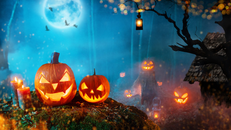 Spooky halloween pumpkins in dark mistery forest. Stock Photo