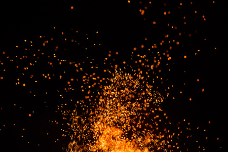 Fire sparks particles with flames isolated on black background