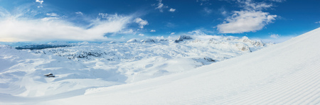 Beautiful panoramic winter landscape with piste. Winter activities and sports motive.