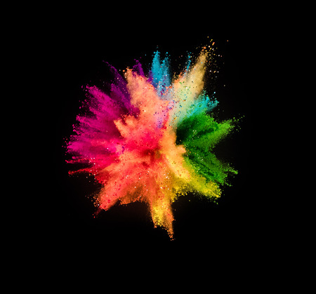 Colored powder explosion isolated on black background. Фото со стока