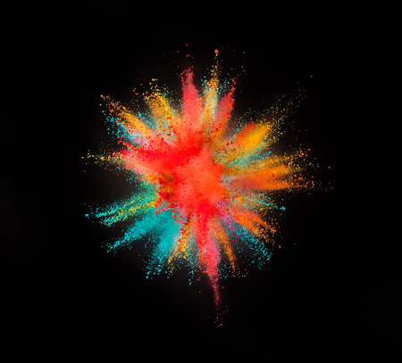 Colored powder explosion isolated on black background. Stock Photo