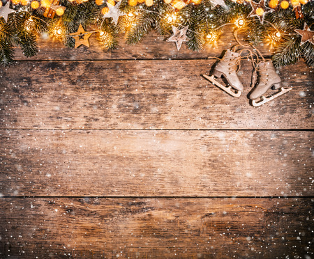 Decorative Christmas rustic background with light bulbs on wooden planks. Celebration and holiday concept. Free space for text.