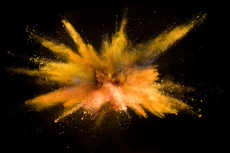 Explosion of colored powder isolated on black background. Abstract colored background Stock Photo - 115160378