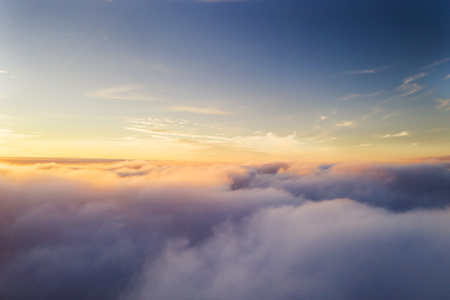 Beautiful sunrise cloudy sky from aerial view. Airplane view above clouds Archivio Fotografico - 115160617