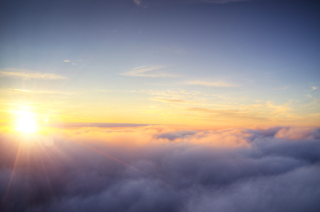 Beautiful sunrise cloudy sky from aerial view. Airplane view above clouds Archivio Fotografico - 115160618