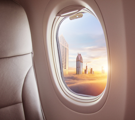 Airplane interior with window view of Dubai city, UAE. Concept of travel and air transportation Stock fotó - 115160643