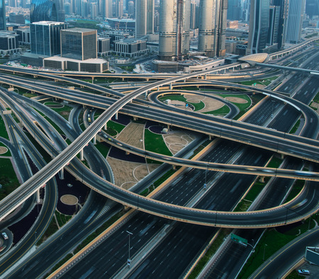 Detail of highway crossroad in Dubai. Dubai is super modern city of UAE, cosmopolitan megalopolis. Фото со стока