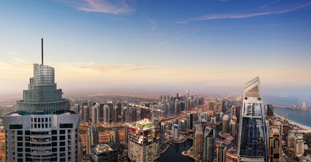 Dubai sunset panoramic view of marina downtown. Dubai is super modern city of UAE, cosmopolitan megalopolis. 写真素材