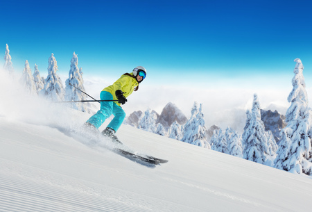 Young woman skiing on piste. Winter sport and recreation in alpen mountain. Stock Photo