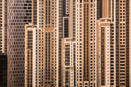 Close up of skyscrapers in Dubai, UAE. Modern city iving in high buildings.