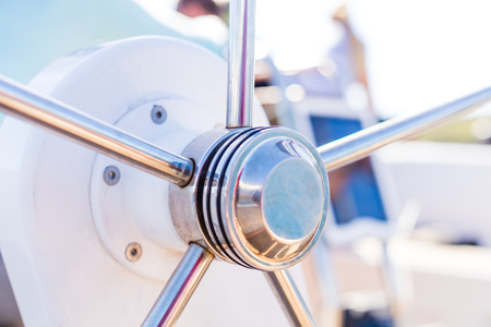 Detail of modern sailing yacht steering wheel. Leasure activities and extreme sport. Low depth of focus.