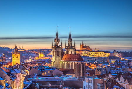 Rooftop view over historical center of Prague, Czech republic, EU. Tyn Church and Prague Castle in beautiful sunset light. Banco de Imagens