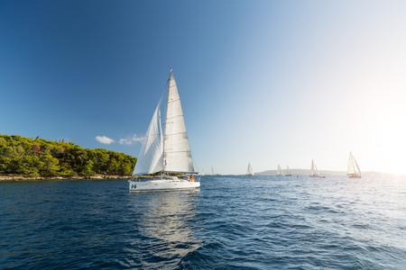 Sailing yachts in sunset light. Summer sport and recreation activities. 版權商用圖片