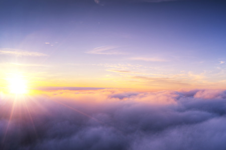 Beautiful sunset cloudy sky from aerial view. Airplane view above clouds Archivio Fotografico - 118587589