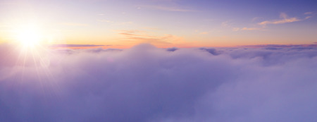 Beautiful sunset cloudy sky from aerial view. Airplane view above clouds Archivio Fotografico - 118587591