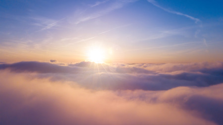 Beautiful sunset cloudy sky from aerial view. Airplane view above clouds Archivio Fotografico - 118587755