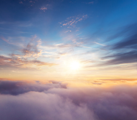 Beautiful sunset cloudy sky from aerial view. Airplane view above clouds Archivio Fotografico - 118588015