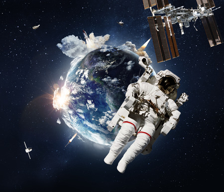 Flying astronaut operating in space nearby of planet Earth.