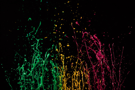 Macro photo of mixed acryl colors isolated on black background. Abstract coloured background. Banco de Imagens