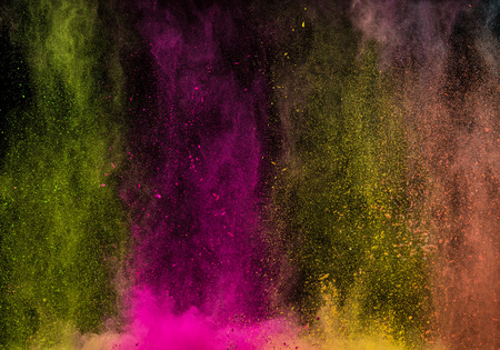Abstract falling colored powder isolated on black background. Abstract colored background Reklamní fotografie