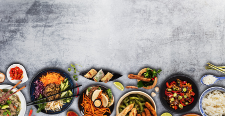 Top view composition of various Asian food in bowls, free space for text Stok Fotoğraf