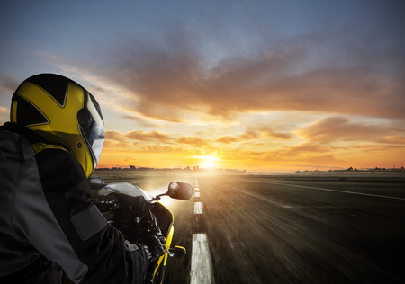 POV of super sport motorcycle driver riding alone on asphalt motorway.