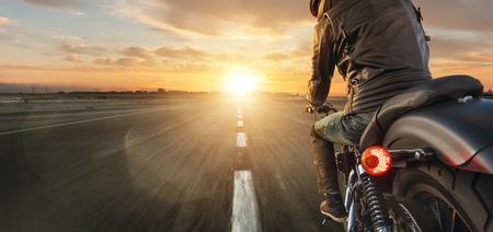 Motorcycle driver riding alone on asphalt motorway. 版權商用圖片