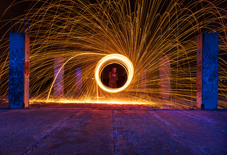 Steel wool fire photography shot on long exposure, making abstract shapes.
