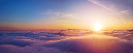 Beautiful sunset cloudy sky from aerial view. Airplane view above clouds Archivio Fotografico - 122888593