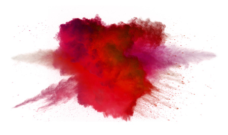 Collision of colored powder isolated on white background. Abstract colored background