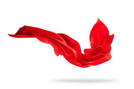 Fliegendes Stück farbiger Stoffbeschaffenheit isoliert auf weiß